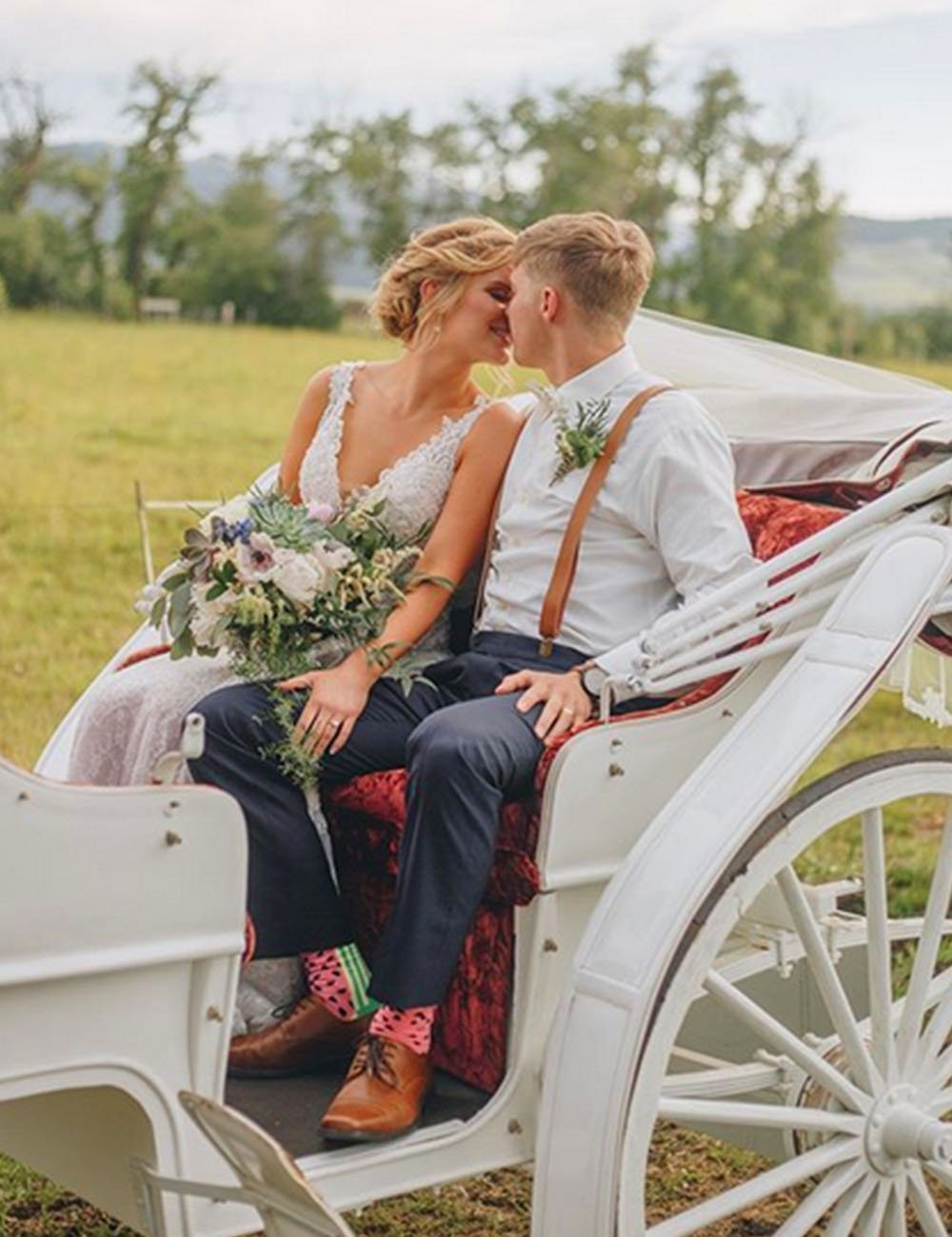 Hart Ranch horse drawn carriage with bride and groom in field