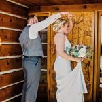 Groom twirls bride during first look at Hart Ranch