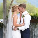 Bride and groom kissing at Hart Ranch Weddings' alter