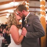 Blonde bride kissing her new husband during first dance at Hart Ranch
