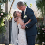 Bride and groom about to kiss at wedding ceremony at Hart Ranch