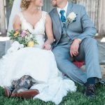 Bride wearing cowboy boots and groom sitting underneath the Hart Ranch Wedding's Two Hearts Chapel